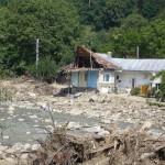 Foto van een huis na overstroming